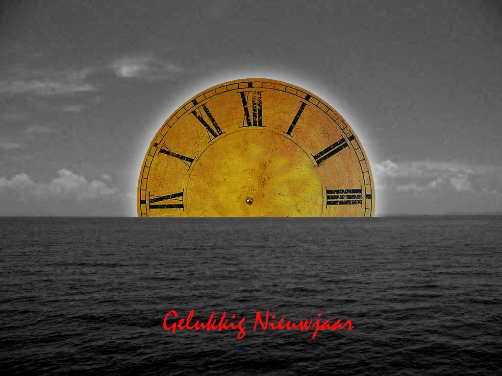 2014 nieuwjaar montage klokzon zee